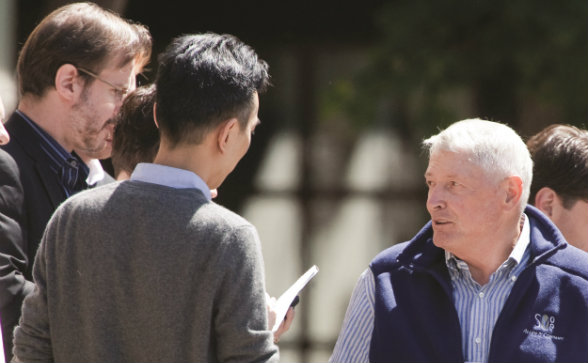 Liberty Media Chairman John Malone speaks with reporters at the Allen & Co. conference in Sun Valley, Idaho.