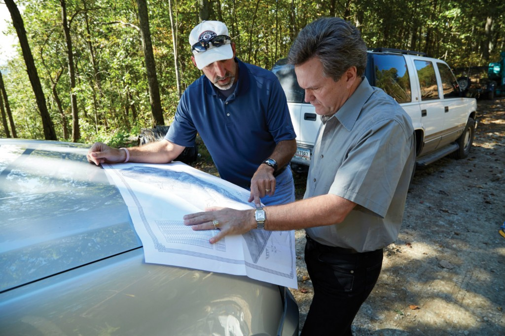 Land Report Editor Eric O'Keefe reviews site plans with Project Manager Matt Logue.