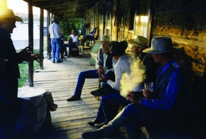 The historic OW bunkhouse porch is the perfect meeting spot for visiting ropers to gather after brandings for a fine cigar and a spot of single malt.