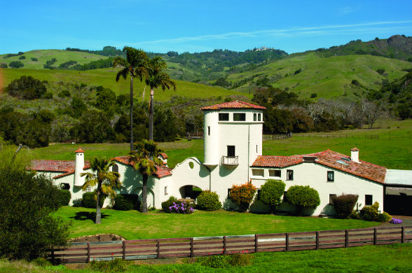 San Francisco architect Julia Morgan spent decades designing scores of structures at San Simeon, including the poultry ranch manager's house (foreground) and the Hearst Castle (background).