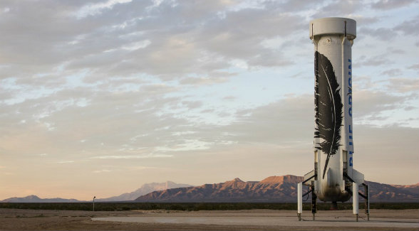 New Shepard on the launch pad at Jeff Bezos's Corn Ranch. Texas's tallest mountain, Guadalupe Peak, looms in the distance.