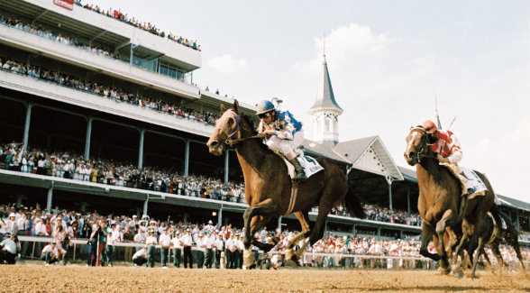 The Scharbauers' Alysheba rocketed from the back of the field to edge Bet Twice and win the 1987 Kentucky Derby in 2:03.40.